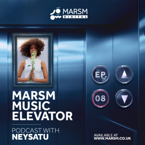 Badiaa Bouhrizi in a white dress, holding a flower in the MARSM Music Elevator